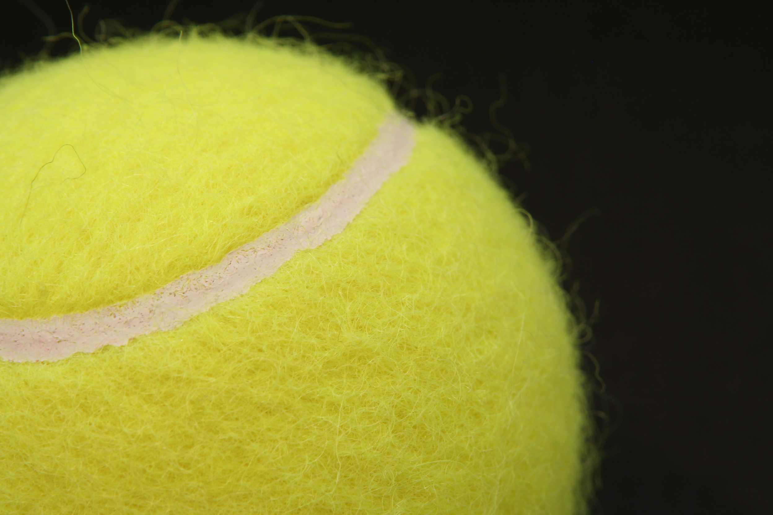 why does a tennis ball have fuzz
